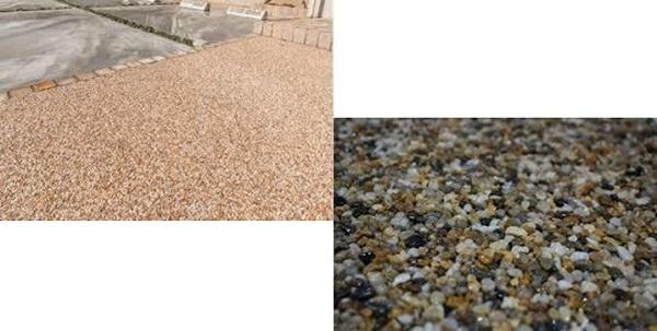 アプローチと駐輪場の土間は天然石やリサイクルガラスを採用した透水性舗装材を使用